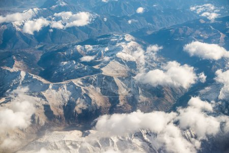 Photo for Dolomites Alps - Italy Mountains Under Clouds. View from Airplane. - Royalty Free Image