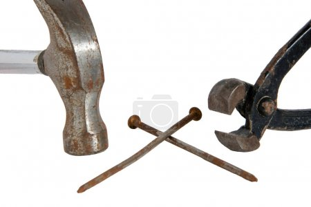Hammer, tongs and two nails
