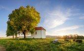 Lonely chapel in farm fields in spring day