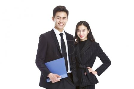 Photo for Studio portrait of young asian corporate business man and woman, looking at camera smiling, isolated on white background. - Royalty Free Image