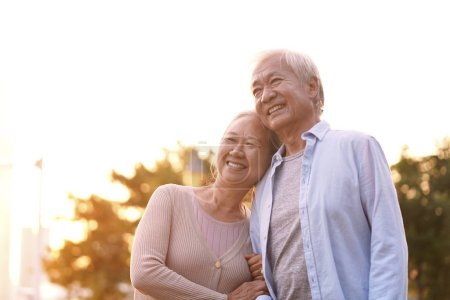 Photo for Outdoor portrait of loving senior asian couple, happy and smiling - Royalty Free Image