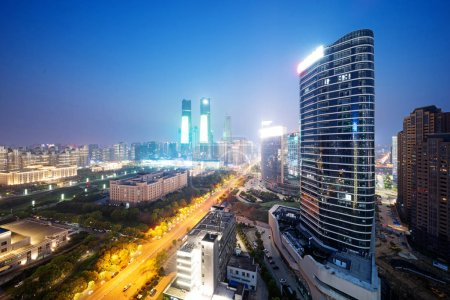 Photo for Bird view at Nanchang China. Skyscraper under construction in foreground. Fog, overcast sky and pollution. Bund (Nanchang) area - Royalty Free Image