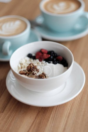 Photo for Breakfast. Cottage cheese with fresh berries and nuts, and cappuccino - Royalty Free Image