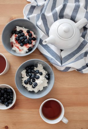 Photo for Cottage cheese with blueberries served with tea - Royalty Free Image