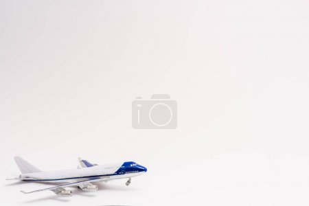 Photo for Small toy plane on white with copy space - Royalty Free Image