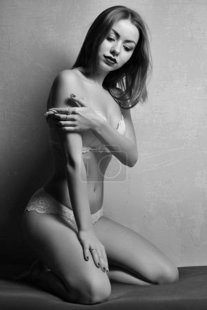black and white portrait of sexy woman posing in lingerie