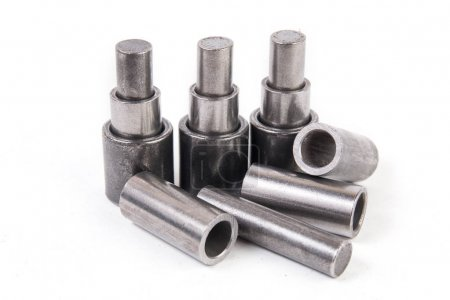 Metal cylinders on white background. Mechanics and...