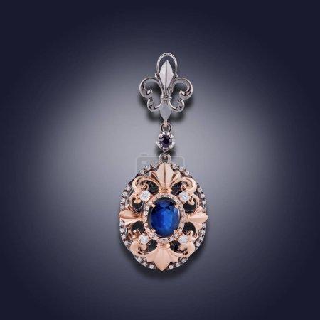 Photo pour Boucle d'oreille avec l'électrodéposition d'or et d'argent sous forme de boucles et avec une pierre bleue - image libre de droit