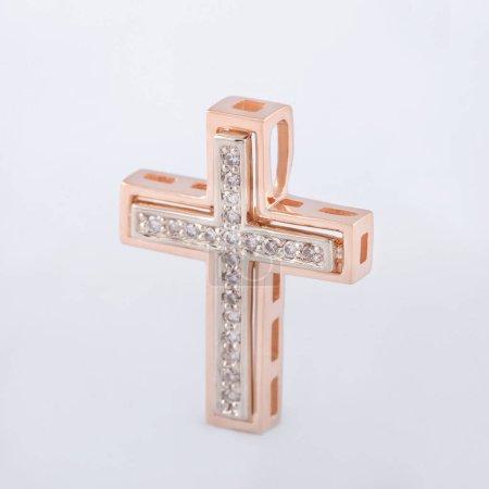 Photo pour Or cross avec pierres swarovski pour un cadeau pour une fille - image libre de droit