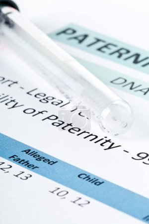 Paternity test result form with buccal swab in test tube