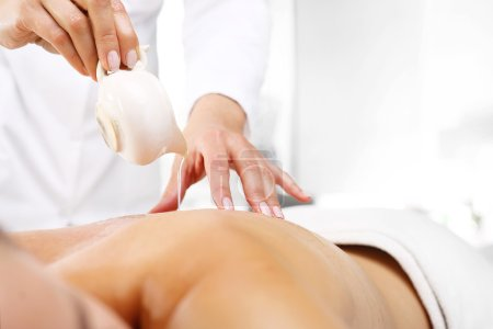 Manual massage with body butter.