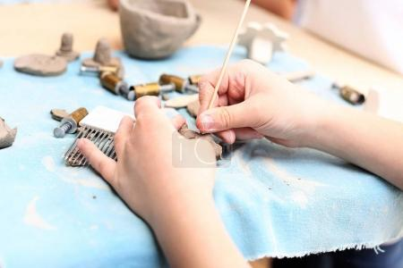 Photo for Children clay from the clay in the studio of artistic ceramics - Royalty Free Image