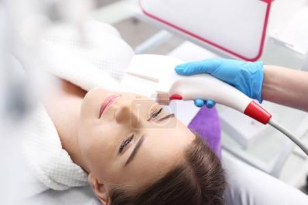 Laser facial skin laser. Woman in the clinic of aesthetic medicine