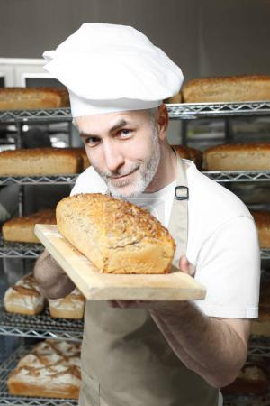 Photo for Baker. The process of baking bread - Royalty Free Image