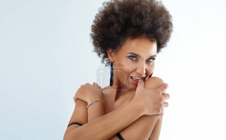 Photo for Portrait of sensual african american woman with afro hairstyle looking at camera. - Royalty Free Image