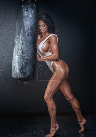 Sexy muscular female boxer posing.