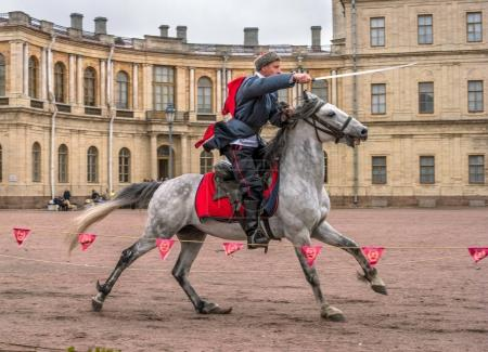 Gatchina, St. Petersburg, Russia - September 30, 2017: Horse show of Cossacks on the parade ground of the Gatchina Palace on the day of the anniversary of Emperor Paul I.