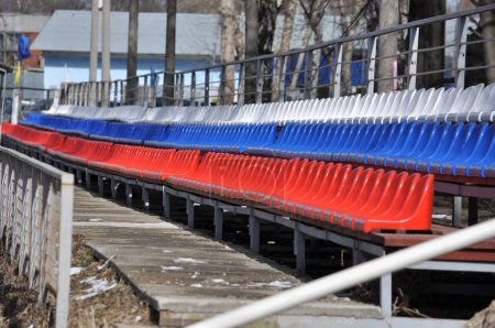 Photo for Plastic seats at the stadium, three series, painted in colours of Russian flag. - Royalty Free Image
