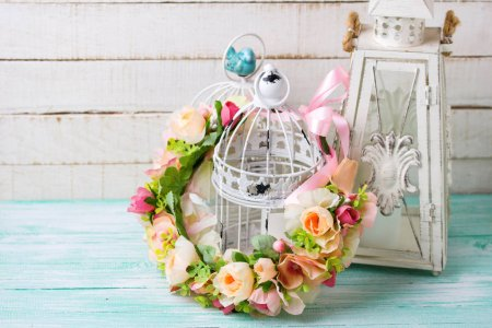 Flower wreath and decorative lantern