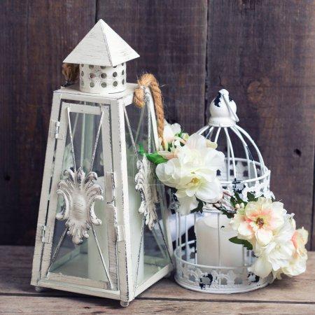 Flower wreath and decorative lantern