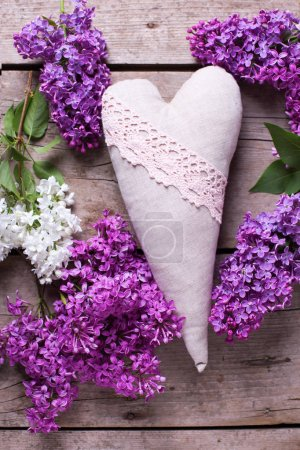 Lilac flowers and decorative heart