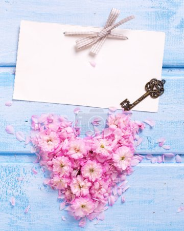 Heart from pink flowers and empty tag