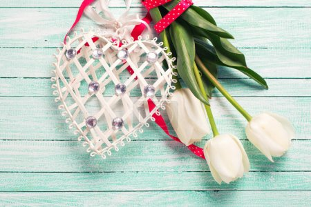 Tulips flowers and  decorative heart