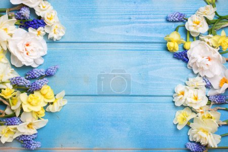 Frame from colorful spring flowers