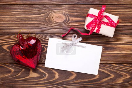 Festive gift box with present and empty tag