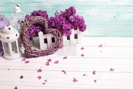 Fresh  lilac flowers, decorative heart  and lanterns