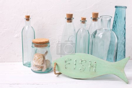 wooden fish, bottles and shells