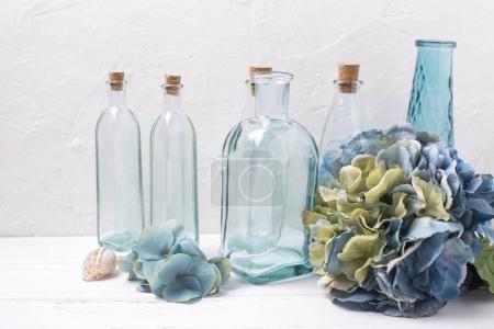 bottles, blue hydrangea flowers and shell