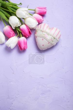 Fresh tulips and decorative heart