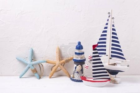 Decorative  wooden toys boats ,  lighthouse and starfish