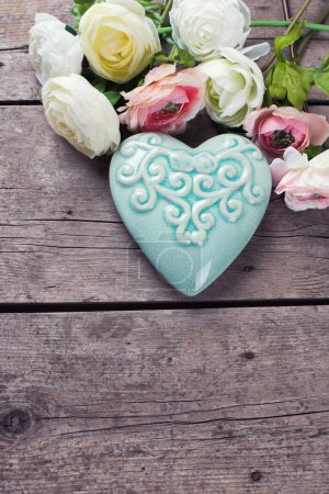 Bright flowers and  decorative heart