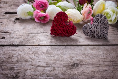 Two decorative  hearts  and flowers