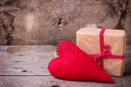 Festive gift box  and decorative heart