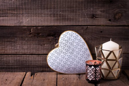 Decorative white heart and  candles