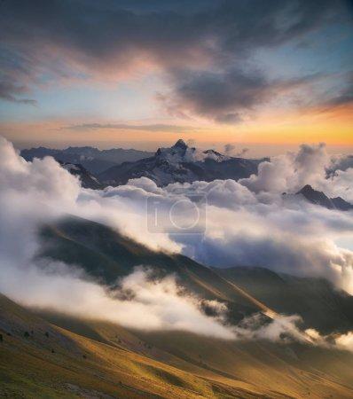 High mountain ridge in clouds
