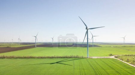 Photo for Wind power station on the field. Concept and idea of alternative energy development - Royalty Free Image