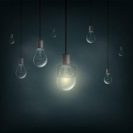 Light bulb lit in the dark.