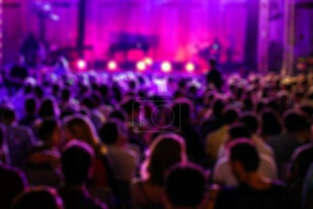 Blurred Image of People at Music Concert