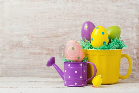 eggs decoration, cup and watering can