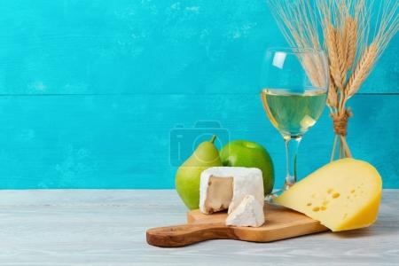 Wine and cheese with fruits