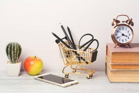 book, alarm clock and smartphone