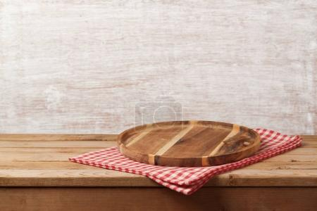 Wooden tray with checked tablecloth