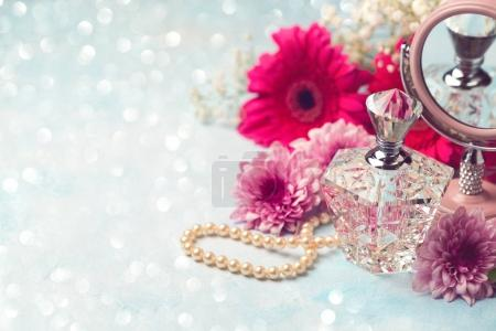 perfume bottle and pearl necklace