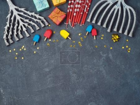 Photo for Hanukkah background with menorah, gift boxes and dreidel over blackboard. View from above. Flat lay - Royalty Free Image