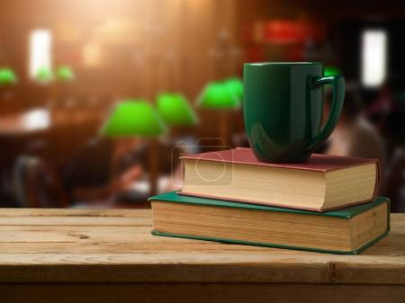 coffee on stack of books