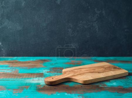 Cutting board on rustic wooden table